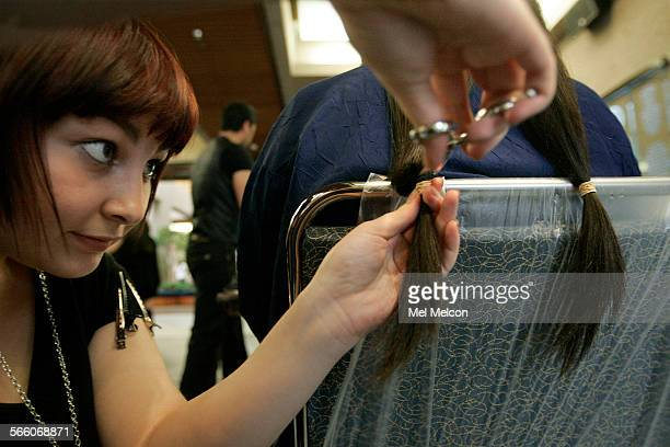 Jen Culin cuts six inches of hair off of Elizabeth Fong a sophomore at UCLA during the 2nd annual Locks of Love event held on the UCLA campus in...