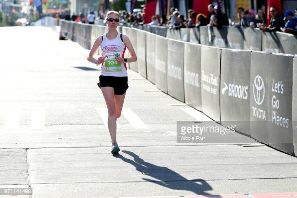 Jen Moroz crosses the finish line to finish second in the Women's 1/2 Marathon during the St Jude Rock 'n' Roll Seattle Marathon 1/2 Marathon on June...