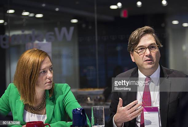 Jen Psaki, director of communications for the White House, left, listens as Jason Furman, chairman of the U.S. Council of Economic Advisors, speaks...