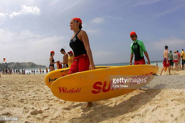 Jen Sedman who is training for her bronze medallion puts away surf rescue boards at Bondi Beach on December 9 2007 in Sydney Australia The Bondi Surf...