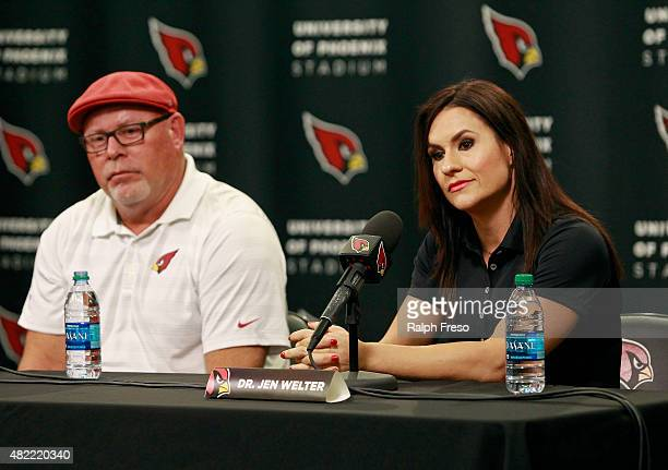 Jen Welter and Arizona Cardinals head coach Bruce Arians listen during a press conference where Welter was named an intern coach for the team on July...