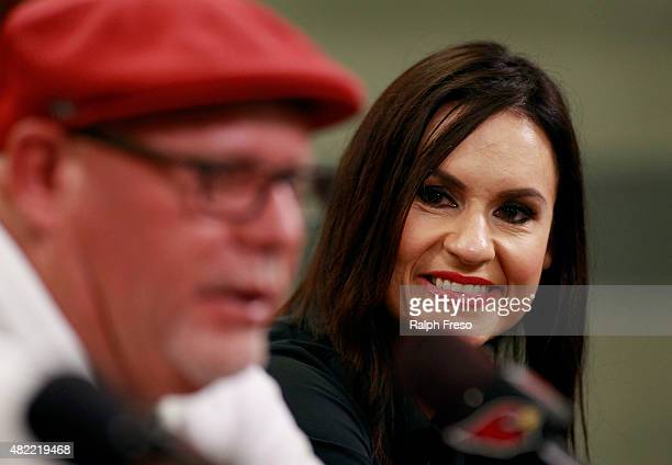 Jen Welter listens as Arizona Cardinals head coach Bruce Arians speaks during a press conference introducing her as an addition to the team's...