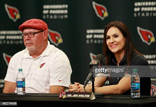 Jen Welter speaks along side of Arizona Cardinals head coach Bruce Arians during a press conference where she was named an intern coach for the team...