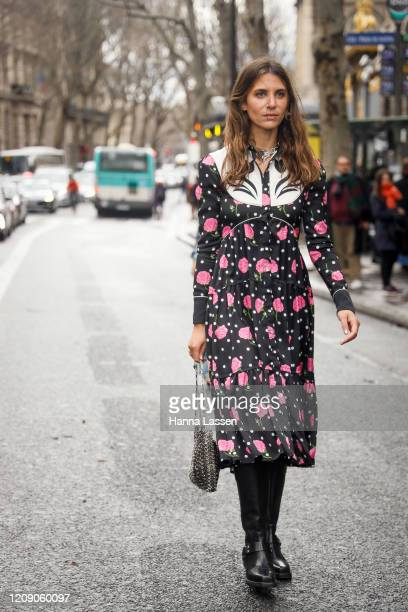 Jen Wonders wearing black floral Paco Rabanne dress and black leather boots outside the Paco Rabanne show during the Paris Fashion Week Womenswear...