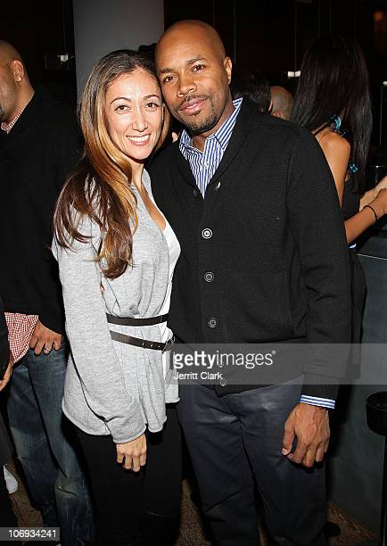 Jen Yu and DJ DNice attend a Hennessey Black party to celebrate DJ DNice signing to Roc Nation DJ's at The Cooper Square Hotel on November 16 2010 in...