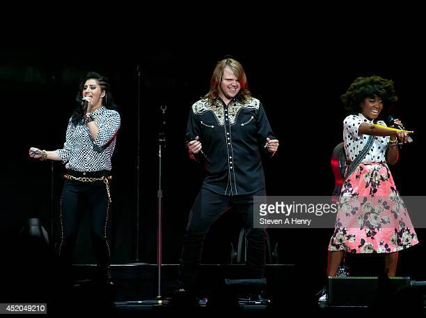 Jena Irene Asciutto Caleb Johnson and Majesty Rose perform during the American Idol Live Tour at Nassau Veterans Memorial Coliseum on July 11 2014 in...