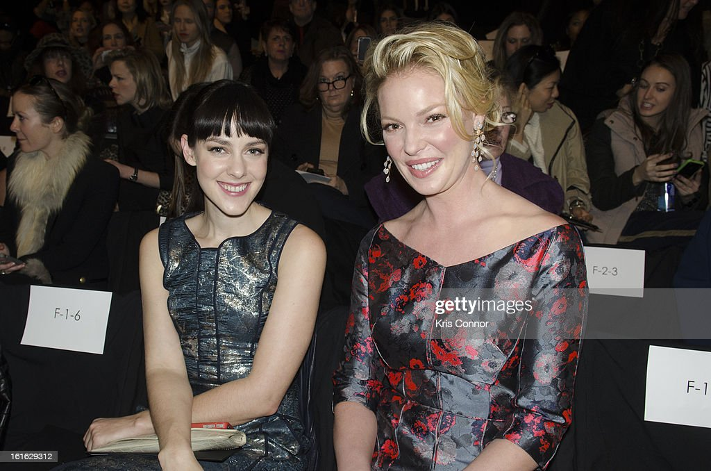 Jena Malone and Katherine Heigl pose during the J. Mendel Fall 2013 Mercedes-Benz Fashion Show at The Theater at Lincoln Center on February 13, 2013 in New York City.