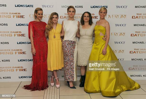 Jena Malone Willow Shields Jennifer Lawrence Nina Jacobson and Elizabeth Banks arriving for the World Premiere of The Hunger Games Catching Fire at...