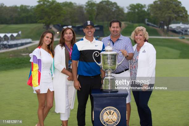 Jena Sims Denise Jakows 2019 PGA Champion Brooks Koepka Bob Koepka and Sherri Koepka pose for a photo with the Wanamaker Trophy during the final...