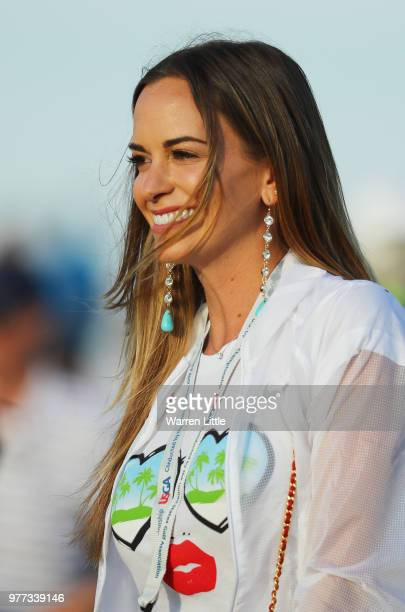 Jena Sims girlfriend of Brooks Koepka of the United States celebrates after Koepka won the 2018 US Open at Shinnecock Hills Golf Club on June 17 2018...