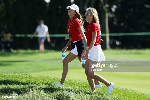 Jena Sims the girlfriend of Brooks Koepka and Tori Slater the girlfriend of Daniel Berger walk during Thursday foursome matches of the Presidents Cup...
