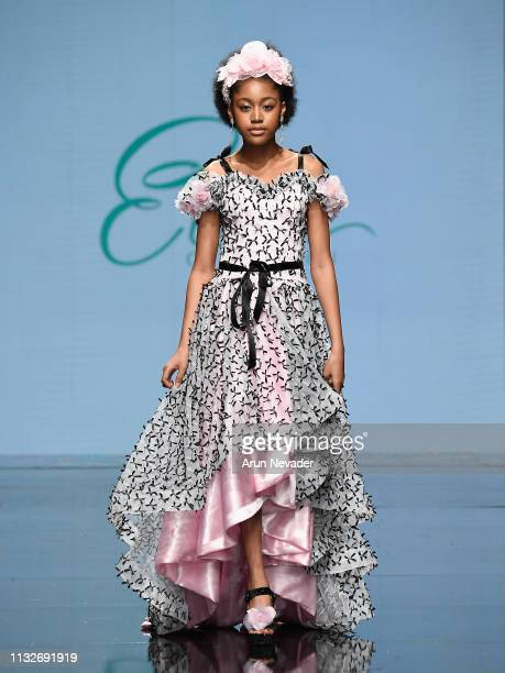 Jenasha Roy walks the runway wearing Elena Couture at Los Angeles Fashion Week FW/19 Powered by Art Hearts Fashion at The Majestic Downtown on March...