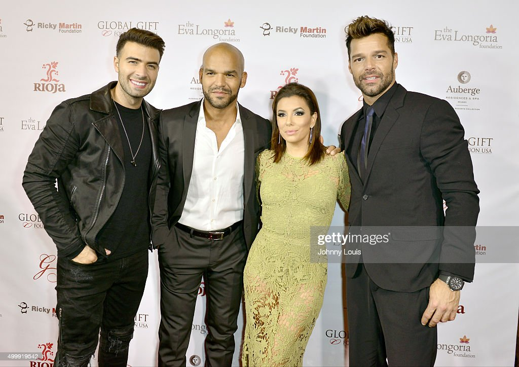 Jencarlos Canela, Amaury Nolasco, Eva Longoria and Ricky Martin attend the Global Gift Foundation Dinner at Auberge Residences & Spa sales office on December 3, 2015 in Miami, Florida.