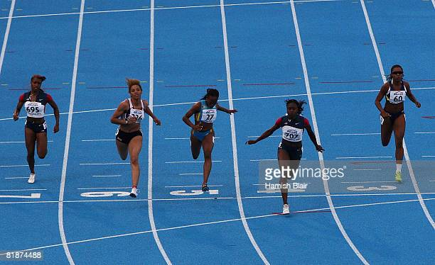 Jeneba Tarmoh of USA crosses the line to take victory from 2nd placed Ashlee Nelson of Great Britain and 3rd placed Sheniqua Ferguson of Bahamas...