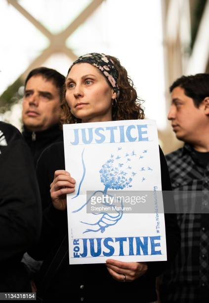 Jenelle Masterson holds a sign reading Justice for Justine during a press conference held by the social justice advocacy group at the Hennepin County...