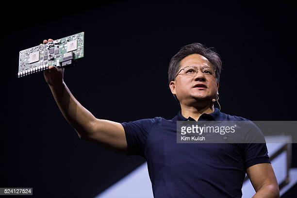 Jen-Hsun Huang, CEO of Nvidia Corp., holds an Nvidia Drive PX Auto-Pilot Computer during his keynote presentation at the GPU Technology Conference in...
