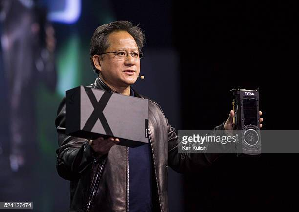 Jen-Hsun Huang, CEO of Nvidia Corp., shows off a Titan C CPU and GeForce GTX Titan X graphics card during the GPU Technology Conference in San Jose,...