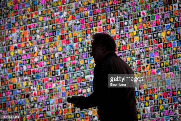 JenHsun Huang president and chief executive officer of Nvidia Corp is silhouetted as he speaks during an event at the 2018 Consumer Electronics Show...