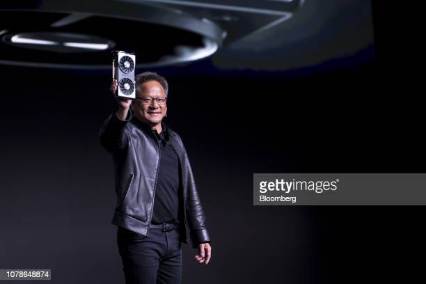 Jen-Hsun Huang, president and chief executive officer of Nvidia Corp., holds up the new Nvidia GeForce RTX 2060 graphics processor during the...