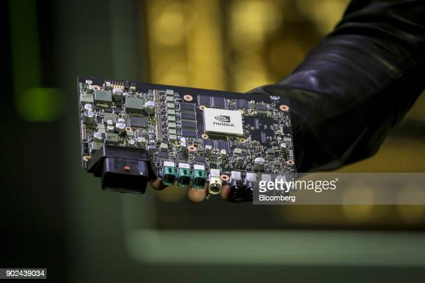 Jen-Hsun Huang, president and chief executive officer of Nvidia Corp., not pictured, holds a Nvidia Drive Xavier Autonomous Machine Processor as he...