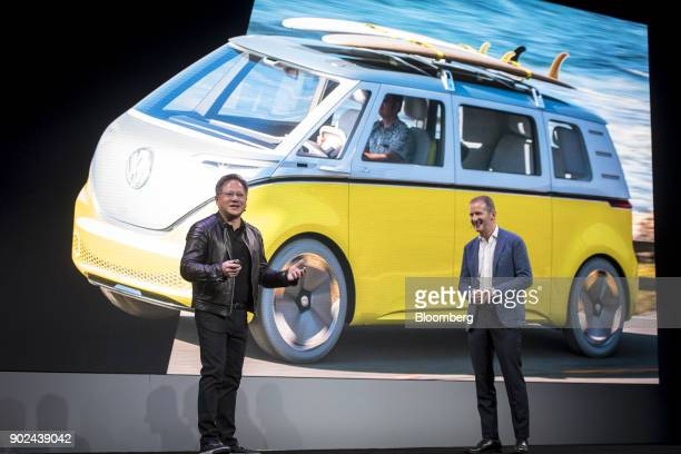 JenHsun Huang president and chief executive officer of Nvidia Corp left speaks as Herbert Diess chief of the Volkswagen AG brand looks on during an...