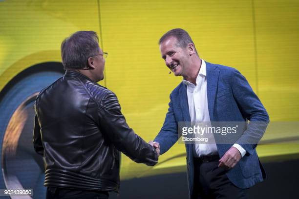 JenHsun Huang president and chief executive officer of Nvidia Corp left shakes hands with Herbert Diess chief of the Volkswagen AG brand during an...