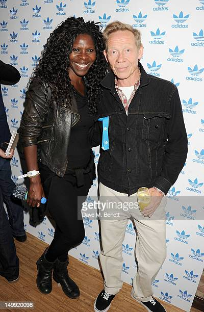 Jeni Cook and Paul Cook arrive as The Stone Roses perform a secret gig at adidas Underground on August 6 2012 in London England