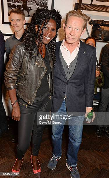 Jeni Cook and Paul Cook attend as John Varvatos launch their first European store in London on September 3 2014 in London England