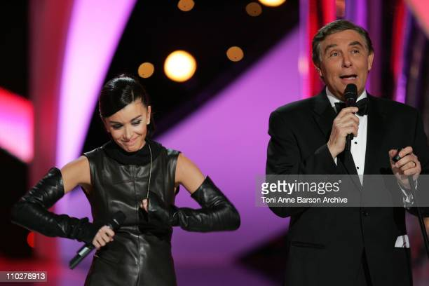 Jenifer Bartoli and JeanPierre Foucault during Miss France 2006 Pageant at Palais des Festivals in Cannes France