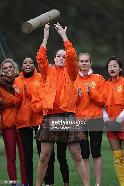 Jenifer Karen Reoch Miss Scotland takes part in the caber tossing at the Miss World Highland Games at Crieff Hotel on October 24 2011 in Crieff...