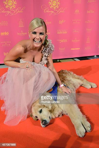 Jenifer Knaeble attends the 'Vita Charity Gala' on October 11 2014 in Wiesbaden Germany The association 'Vita eV' trains 'assistance dogs' for...