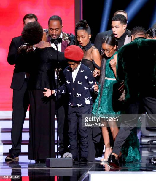 Jenifer Lewis, Kenya Barris, Miles Brown, Yara Shahidi, Marsai Martin, Marcus Scribner, and Anthony Anderson react after their trophy for the...