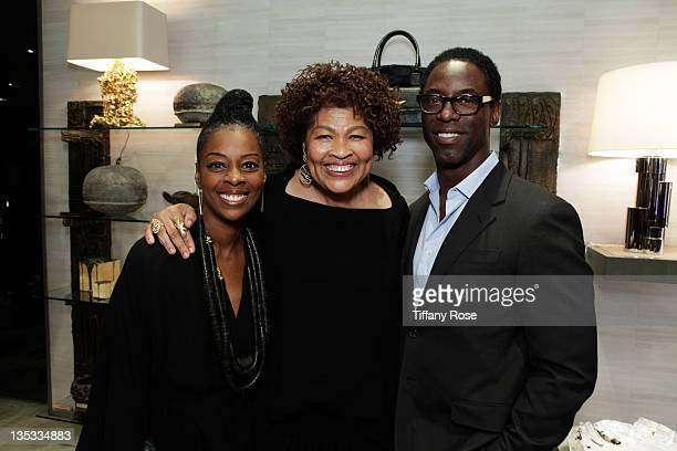 Jenisa Marie Washington Opal Stone and Isaiah Washington attend the Opal Stone Luxury Handbags And Fine Jewelry Launch at Gray Gallery on December 8...