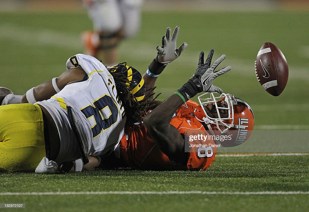 A.J. Jenkins #8 of the Illinois Fighting Illini can't hold on to the ball after being hit by J.T. Floyd #8 of the Michigan Wolverines at Memorial Stadium on November 12, 2011 in Champaign, Illinois. Michigan defeated Illinois 31-14.