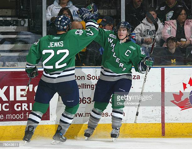 Jenks of the Plymouth Whalers congratulates teammate Chris Terry on scoring a goal in a game against the London Knights on November 18, 2007 at the...