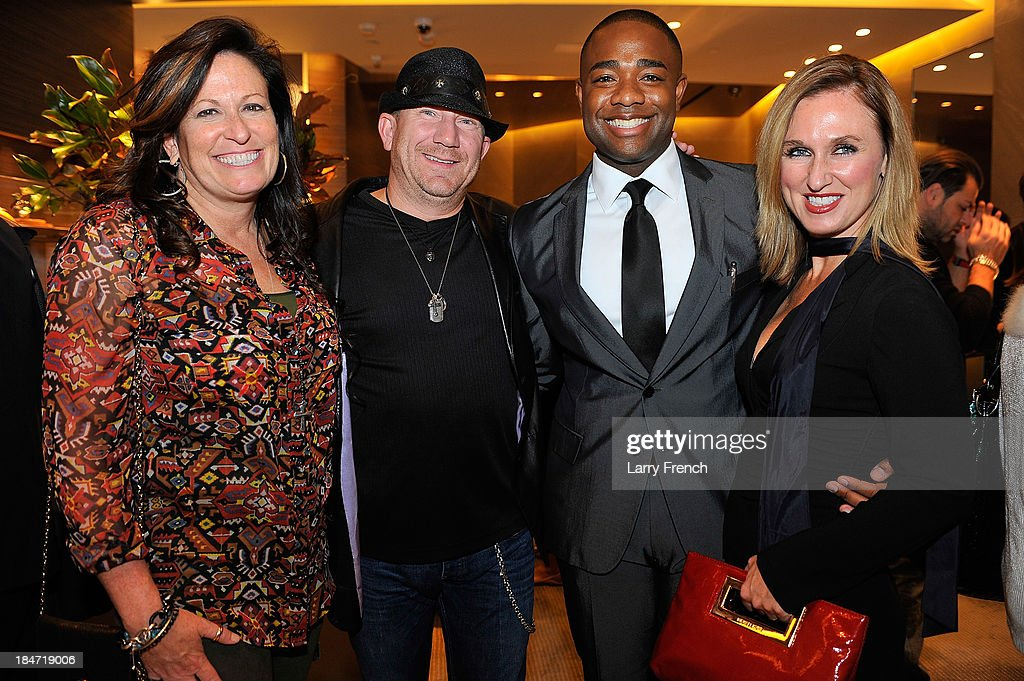 Jenn Flamia, Mike Flamia, Brandon Clay and Jennifer Harlow are seen at the David Yurman Meteorite Launch With Chris Baker on October 15, 2013 in Mclean, Virginia.