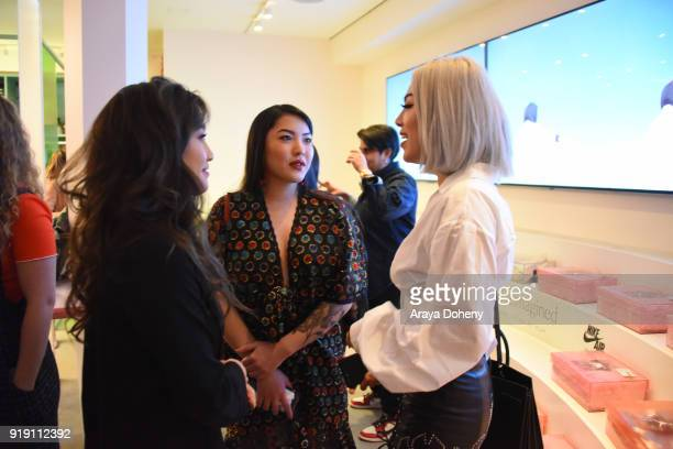 Jenn Im Stephanie Villa and Ellen V Lora attend the Flaunt Magazine Dinner with Nike and Revolve on February 15 2018 in Los Angeles California