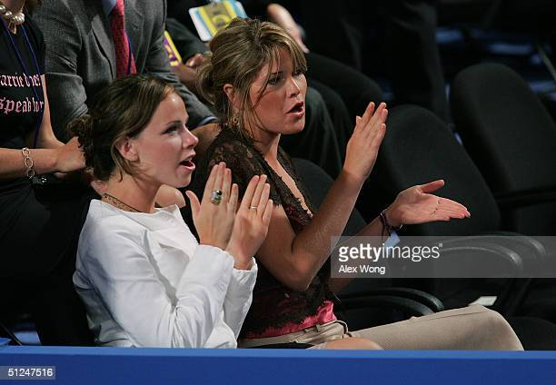 Jenna and Barbara Bush the daughters of President George W Bush applaud at the opening of the evening session of day one of the 2004 Republican...