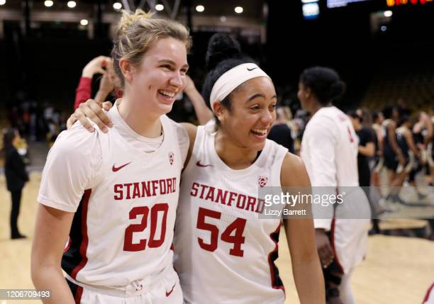 Jenna Brown hugs Estella Moschkau of the Stanford Cardinal after her buzzerbeating half court shot to win the game at the end of the fourth quarter a...
