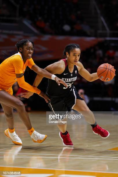 Jenna Brown of the Stanford Cardinal drives past Zaay Green of the Tennessee Lady Volunteers during their game at ThompsonBoling Arena on December 18...