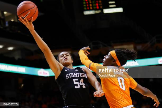 Jenna Brown of the Stanford Cardinal shoots a layup with Rennia Davis of the Tennessee Lady Volunteers defending during their game at ThompsonBoling...