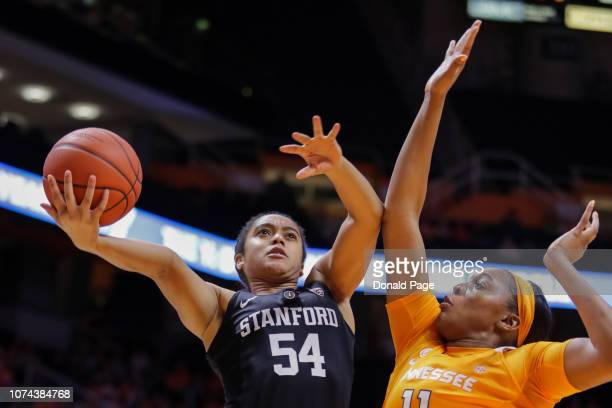 Jenna Brown of the Stanford Cardinal shoots the ball past Kasiyahna Kushkituah of the Tennessee Lady Volunteers during their game at ThompsonBoling...