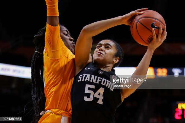 Jenna Brown of the Stanford Cardinal shoots the ball with Zaay Green of the Tennessee Lady Volunteers during their game at ThompsonBoling Arena on...