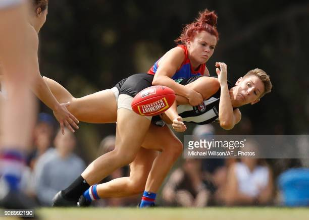 Jenna Bruton of the Bulldogs and Emma Grant of the Magpies in action during the 2018 AFLW Round 05 match between the Collingwood Magpies and the...