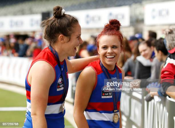 Jenna Bruton of the Bulldogs celebrates with Emma Kearney of the Bulldogs during the 2018 AFLW Grand Final match between the Western Bulldogs and the...