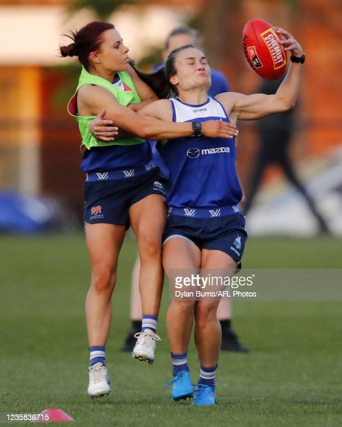 Jenna Bruton of the Kangaroos and Ashleigh Riddell of the Kangaroos compete for the ball during the North Melbourne training session at Arden Street...