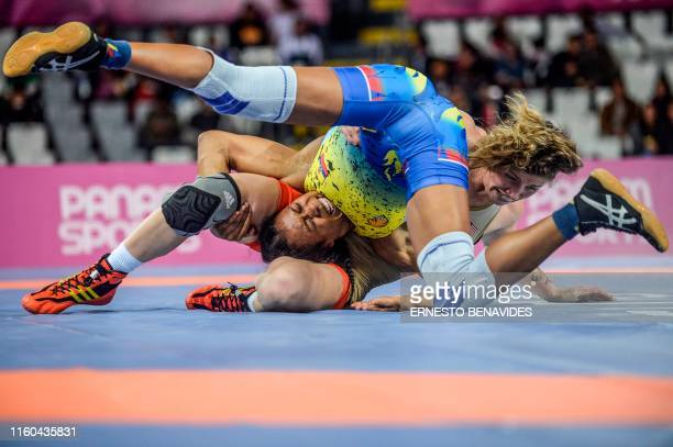 US Jenna Burkert and Ecuador's Lissette Antes compete in the Wrestling Women's Freestyle 57 kg Final during the Lima 2019 PanAmerican Games in Lima...