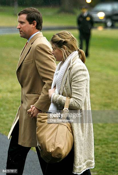 Jenna Bush daughter of US President George W Bush and her husband Henry Hager walk across the South Lawn after arriving to the White House January 10...