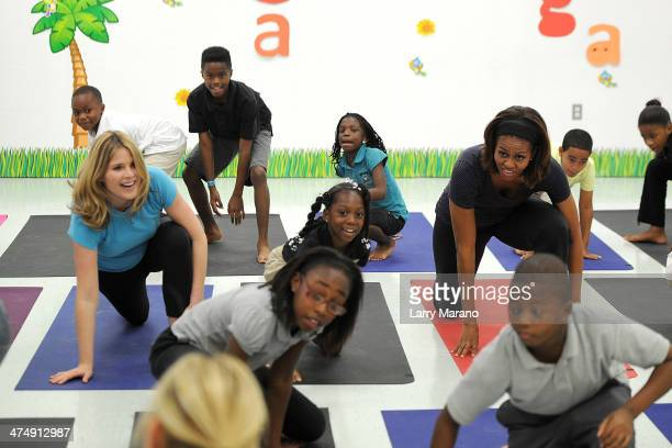 Jenna Bush Hager and First Lady Michelle Obama participate in a yoga class during a visit to the Gwen Cherry Park NFL/YET Center as she celebrates...