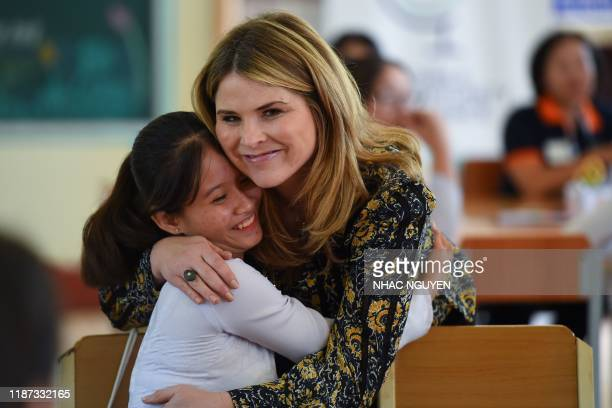 Jenna Bush Hager, daughter of former US president George W. Bush, embraces a Vietnamese student in Can Giuoc district, Long An province on December...